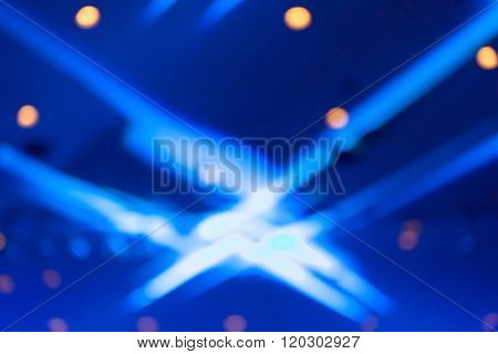 Blurred Photo Of Stage Lights In Live Concert Hall.
