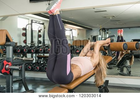 Young Woman Exercising On Adjustable Decline Bench