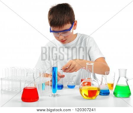 Clever little boy doing a chemical experiments, isolated on white