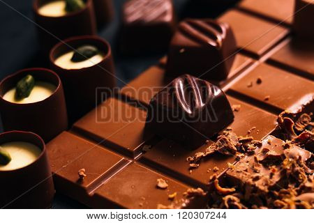 Many Chocolate Sweets With  Pistachio On Black Background