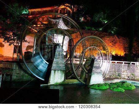 Old watermill wheel in Lijiang by night