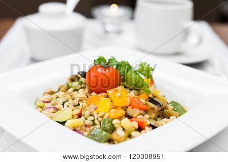 Pearl Barley Porridge With Vegetables On Square Plate