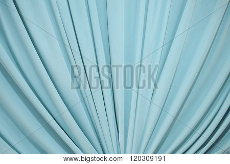 Background Draped With Blue Fabric