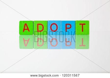 Adopt - An Inscription From Children's Blocks
