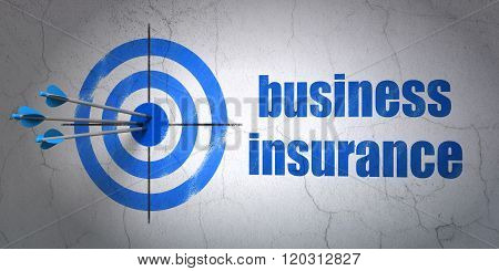 Insurance concept: target and Business Insurance on wall background