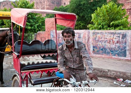 September 4 2006: India Khajuraho. Indian rickshaw. In India many men are engaged in the transport of tourists and locals in managed bike with a sidecar. One rickshaw can carry three people in his carriage.