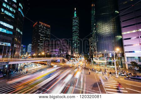 Traffic On Xinyi Road And View Of Taipei 101 At Night, In Taipei, Taiwan.