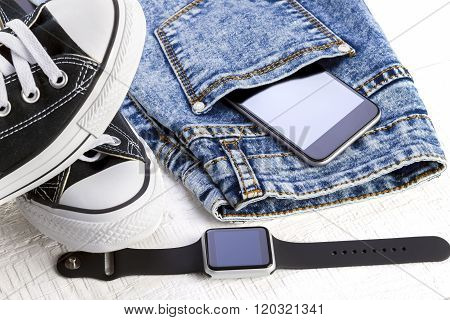 Jeans And Fashion Accessories On White Wooden