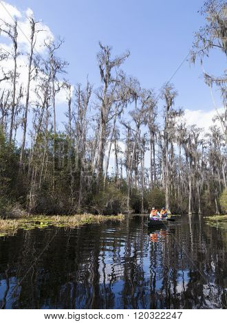 OKEFENOKEE SWAMP, GEORGIA, USA-FEBRUARY 19, 2016: Unidentified tourists canoe throught the Okefenokee Swamp in Georgia, USA