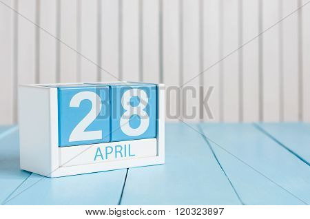 April 28th. Tax Day. Image of april 28 wooden color calendar on white background.  Spring day, empty
