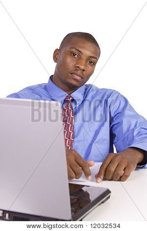 Black Businessman At His Desk Working