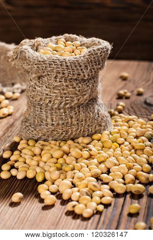 Soybeans on a wooden background. rustic style