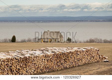 Wood Logs And Stone House