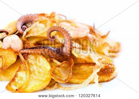 Fried potatoes with octopus. White background. macro view