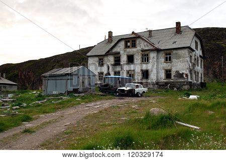 Abandoned homes and cars of the village Teriberka Murmansk region