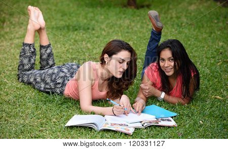 Girls Pointing In Notebook