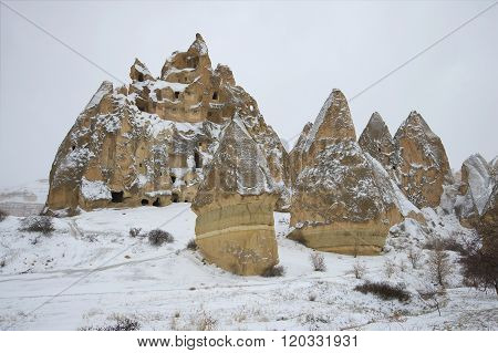 View of the ancient cave city january day. The surrounding area of Goreme, Turkey