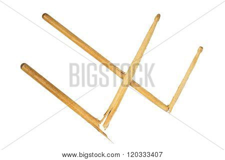Two Broken Wooden Drumsticks Isolated On White