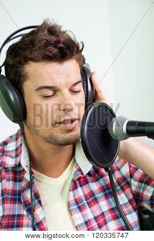 Male Singer Performing In Recording Studio