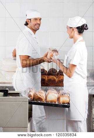 Baker's Packing Bread Loaves In Bakery