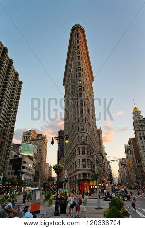 NEW YORK - CIRCA SEPTEMBER 2015: Busy Street Scene on Fifth Avenue in front of Historic Flatiron Building at Dusk with Copy Space in Blue Sky, Manhattan, New York City, New York, USA