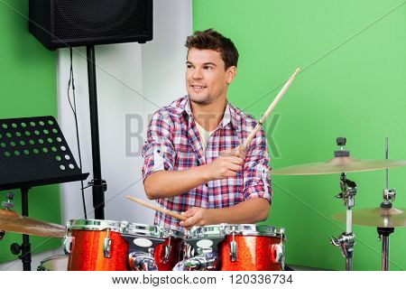 Professional Playing Drums And Cymbal In Recording Studio
