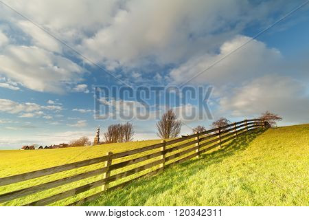 Fence On Pasture And Beautiful Sky In Hindeloopen