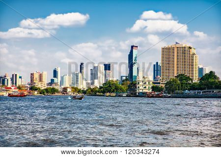 Business district cityscape from Jaopraya river in Bangkok, Tailand.