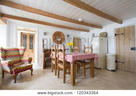 CORNWALL, UK - CIRCA JULY 2015.The interior of a typical Cornish holiday cottage showing a cottage style kitchen with dining area