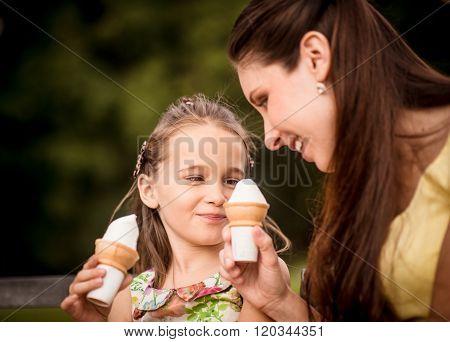 Mother and child enjoying icecream