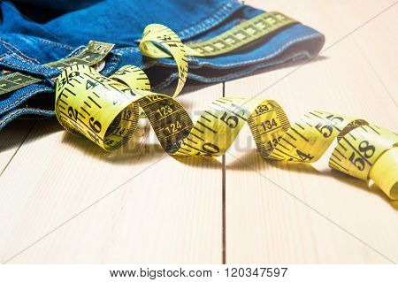 Jeans And A Measuring Tape.concept Of Loosing Weight.fruits For Weight Loss