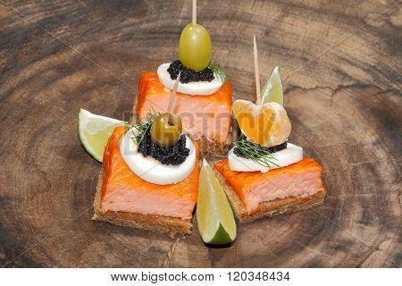 Toast, Smoked Salmon, Egg, Caviar, Orange, Grape, Olive