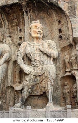 Longmen Caves in Luoyang. Statue of Warrior