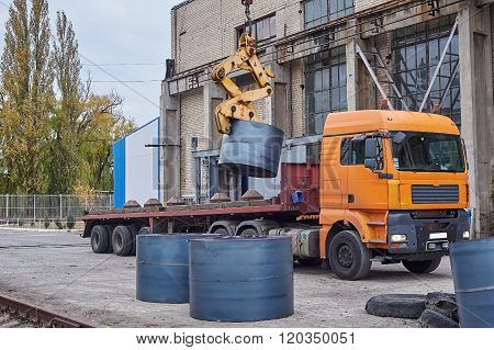Cranes Unloading A Freight Transport With Still Rolls