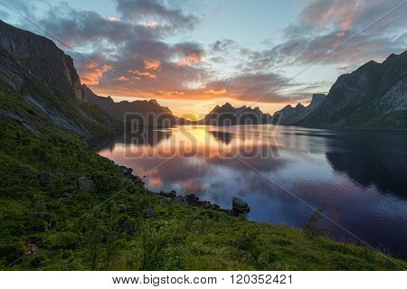 Scenic sunset near the great mountains in lofoten islands, Kjerkfjorden, bunesfjorden