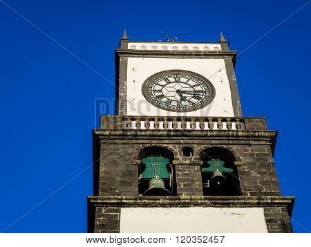 Clock tower of Church of San Sebastian at Ponta Delgada in Ponta Delgada, Sao Miguel Island, Azores, Portugal