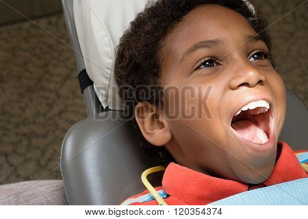 Boy with mouth open