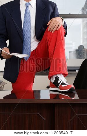 Businessman wearing tracksuit bottoms