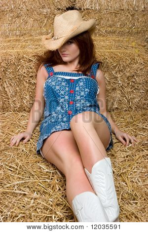 Pretty Cowgirl in Hay