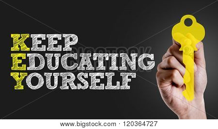 Hand writing the text: Keep Educating Yourself