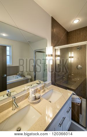 Luxury bright bathroom with a shower cabin. Interior design.