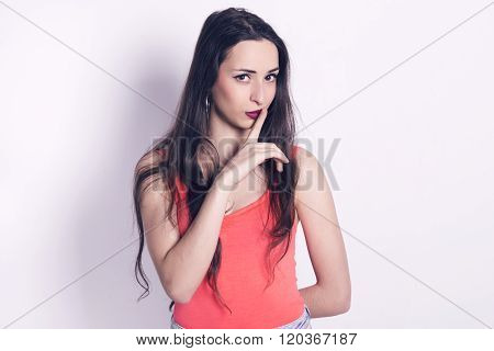 Beautiful Girl With A Finger On Her Lips
