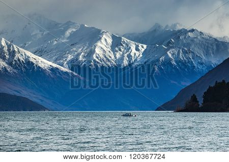 Snow Mountain Scene And Motor Boat Over Lake Wanaka Beautiful Destination In South Island New Zealan