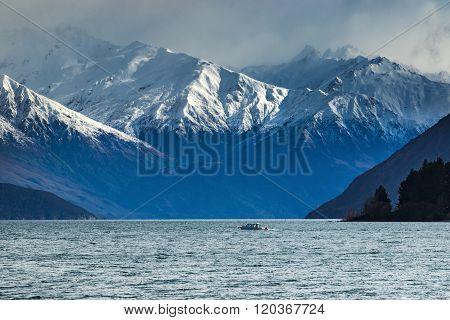 Snow Mountain Scene And Motor Boat Over Lake Wanaka Beautiful Destination In South Island New Zealan