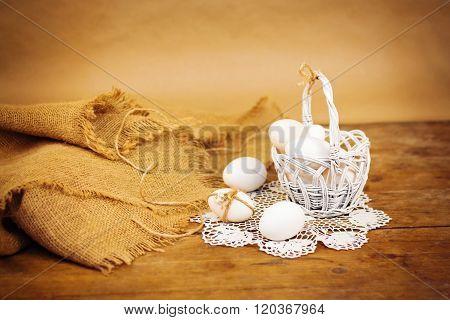 White Easter eggs in white basket