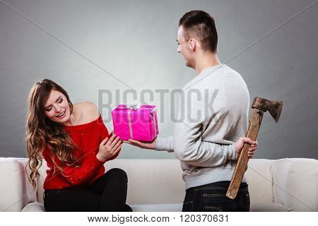 Insincire Man Holding Axe Giving Gift Box To Woman