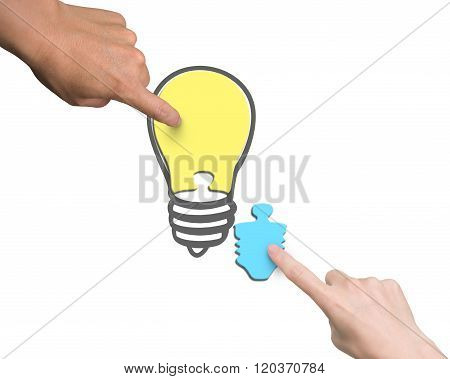 Woman And Man Two Hands Assembling One Bulb Shape Puzzle