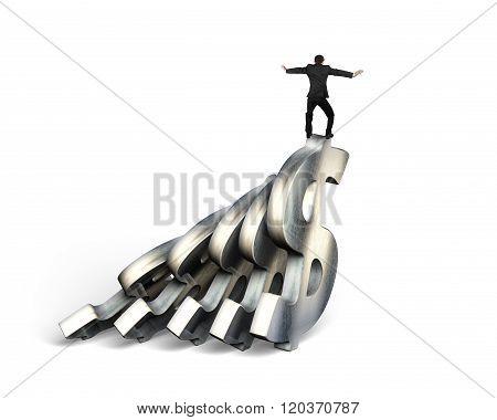 Businessman Balancing On Dollar Money Domino