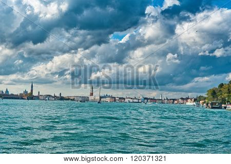 Venice panoramic skyline cityscape looking across the water of St Marks basin from St Elena to the Campanile and San Giorgio Maggiore, Veneto, Italy