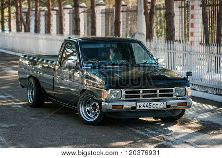 Motor Car Nissan Datsun Pickup Truck At The City Street